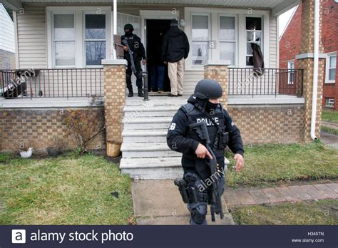 buying a house in detroit michigan detroit police officers raid a house in detroit michigan usa stock photo royalty