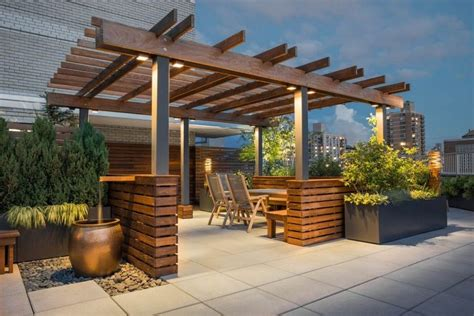 Roof Top Garden Ideas Exterior Excellent Home Roof Top Terrace Design Using Wooden Pergola Roof Also Jar Water Feature