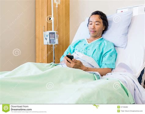 man using cell phone in bed stock images image 33817024 patient using mobile phone on hospital bed stock