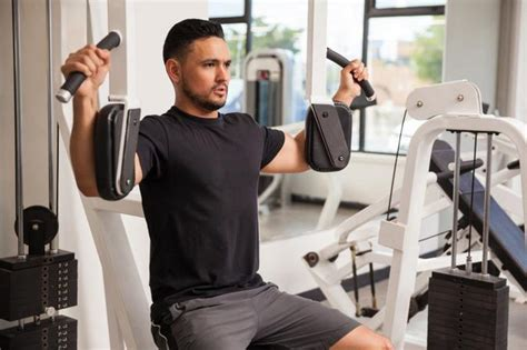 Weight Bench Bar Weight The Muscles Used In A Pec Deck Machine Livestrong Com