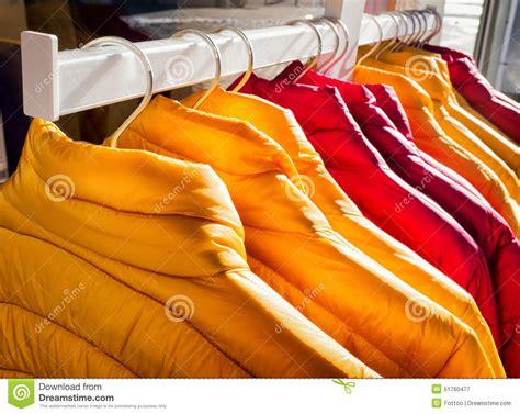 H918693 Jaket Parasit Yellow Two Color Sports Jacket Import row of jackets stock photo image 51760477