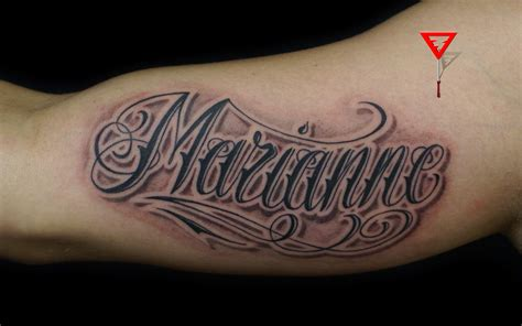 name tattoos with designs around them black and white lettering on arm tattoes idea