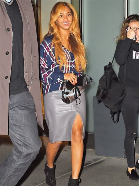 beyonce gives a glimpse of leg in a leather skirt and a