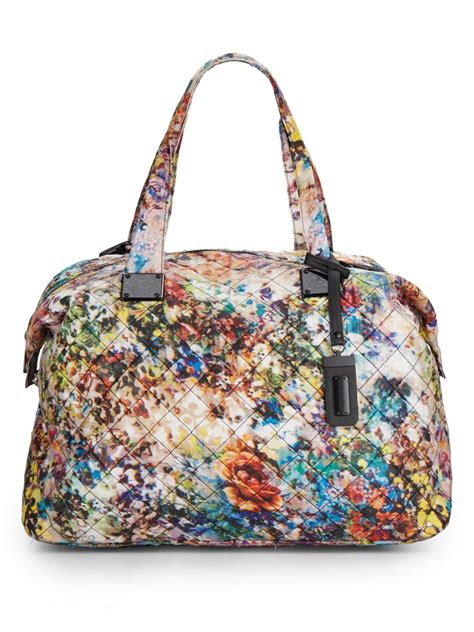 Burch Tote Vs Steve Madden Bag by Lyst Steve Madden Quilted Floral Print Duffle Bag In White