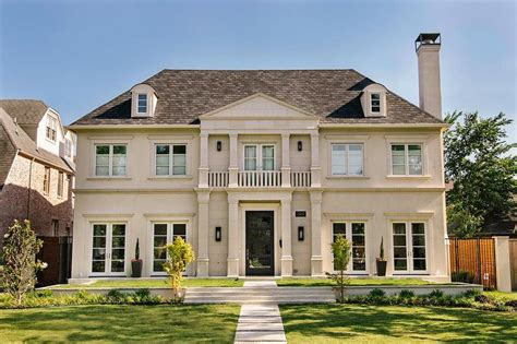 limestone home exterior with balcony transitional