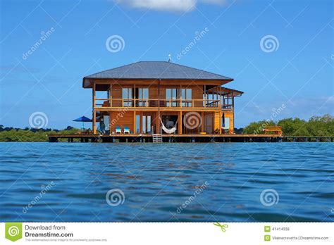 house over water wooden tropical home over water of caribbean sea stock