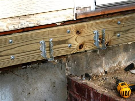Joist Hangers For Decks by How To Build A Simple Deck Hgtv
