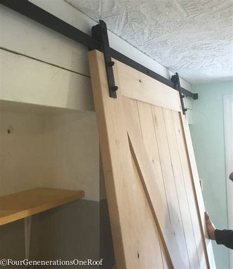 diy sliding barn door our diy sliding barn doors tutorial four generations