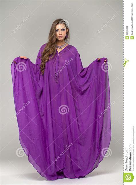 Tunic Arabic portrait of the in purple tunic arabic stock