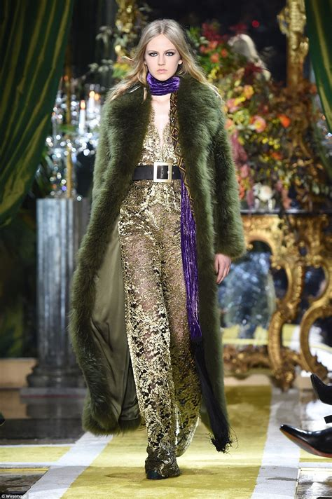 Fashion Weeks Coats Couture In The City Fashion by Roberto Cavalli And Gucci Models Walk The Runway In 70s