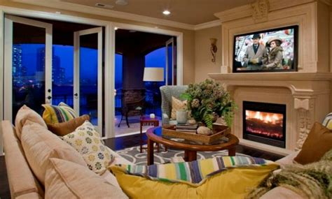 the pros and cons of having a tv over the fireplace tv over fireplace height tvs over fireplaces the pros
