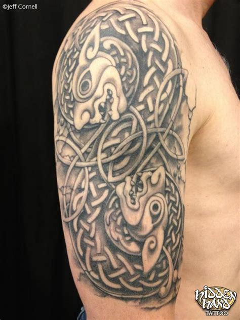 black and grey celtic half sleeve hidden hand tattoo