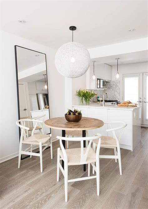 gray trestle dining table  white wishbone chairs transitional kitchen