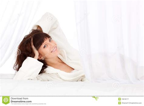 lay on the bed beautiful woman laying on bed royalty free stock