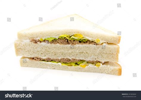 Tuna Mayo Pyramid Bread white bread sandwich with tuna fish salad mais and mayonnaise isolated on white background