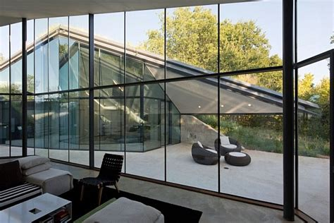 modern german house clad in glass offers unabated lake views underground house encased in glass offers a modern take on