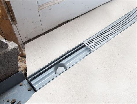 Drain In Front Of Garage Door by Trenchdrain Basement Garage Entry Drainage