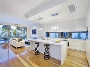 Classic island kitchen design using floorboards kitchen photo