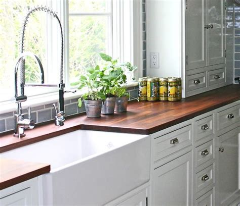 white kitchen cabinets with butcher block countertops i think i m going to do the white shelves and cabinet with
