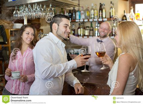 bartender entertaining guests stock photo image 52619416