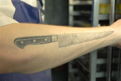 right arm tattoos chef knife on right arm