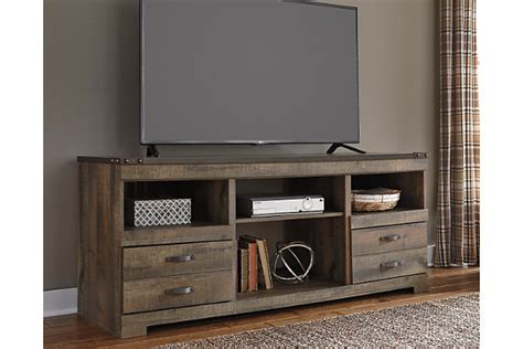 Home Decor Outlet Stores by Trinell 63 Quot Tv Stand Ashley Furniture Homestore