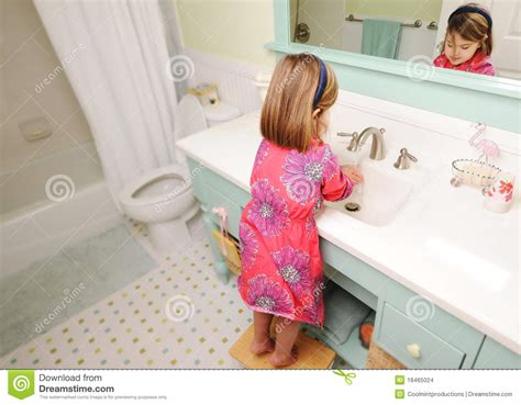 girl in the bathroom young girl washing hands in bathroom stock photo image