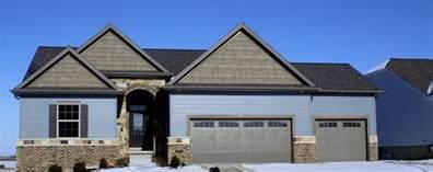 home blue houses with dark brown garage doors wageuzi