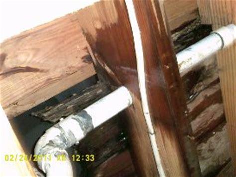 water leaking from upstairs bathroom plumbing system