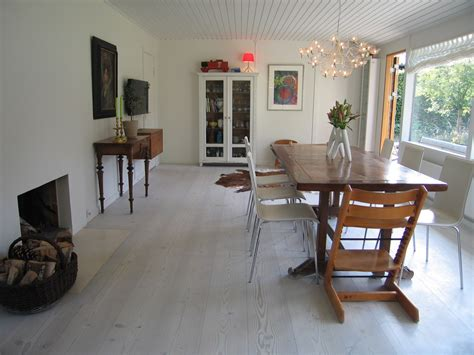 Dining Room With Grey Floor White Washed Wood Floor Meets Home With Industrial Style