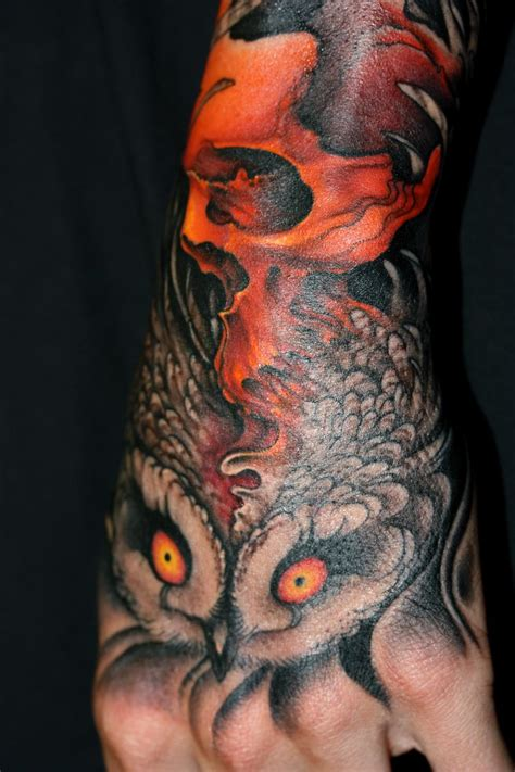 owl hand tattoo back