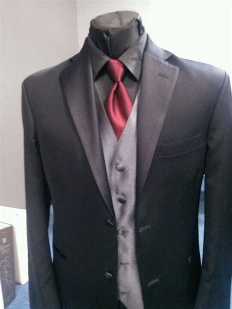 black suit red shirt with vest charcoal gray tux blue tie all black tuxedo with red tie