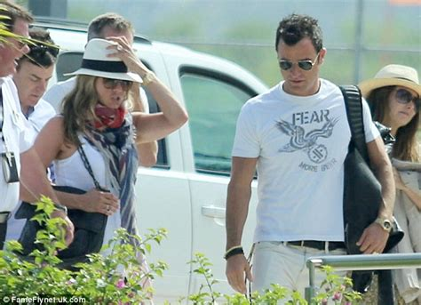 jennifer aniston and justin theroux jet off on honeymoon jennifer aniston and justin theroux look downcast as they