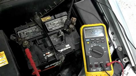 Ripple Premium Car Hook Putih battery load test with a multimeter