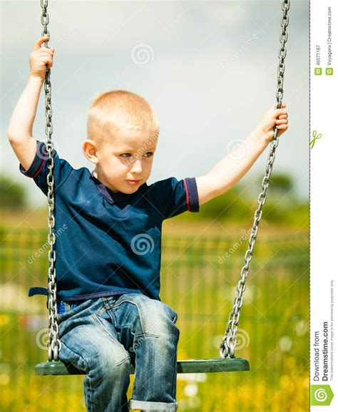 kid active swing little boy having fun at the playground child kid playing