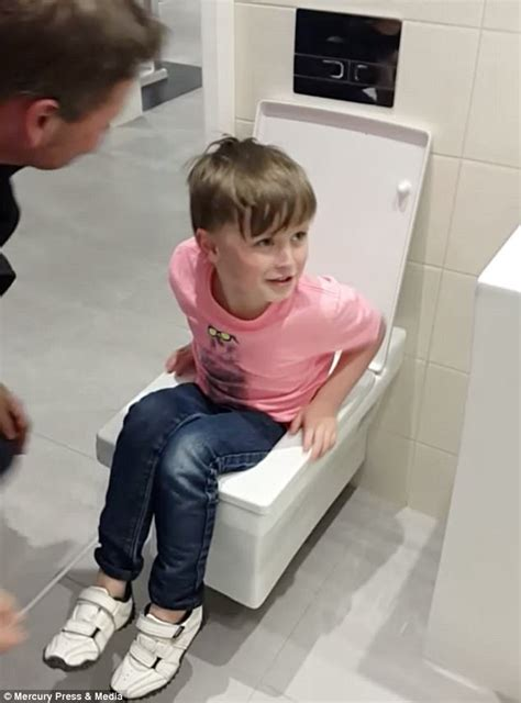 bathroom porm six year old boy gets stuck in display toilet at store