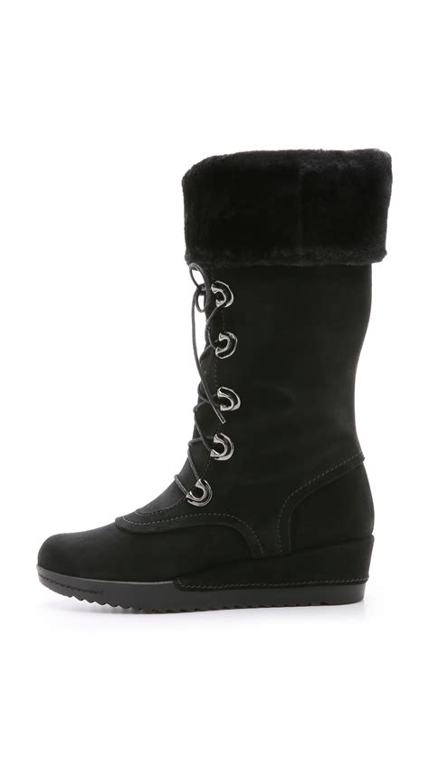 stuart weitzman bigfoot faux fur lined boots black in