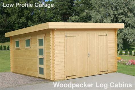 Woodpecker Log Cabin by Garage Low Profile Woodpecker Log Cabins