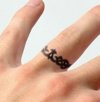 tattoo rings pictures 43 awesome wedding ring tattoos weddingomania