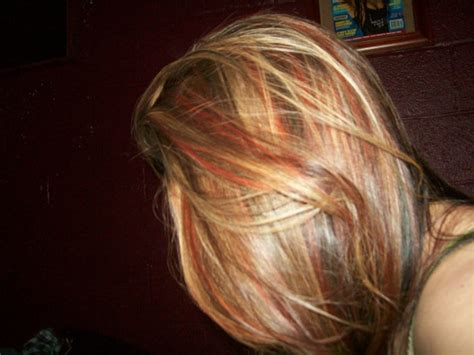 brown hair with red underneath blonde highlights over brown hair with red and black
