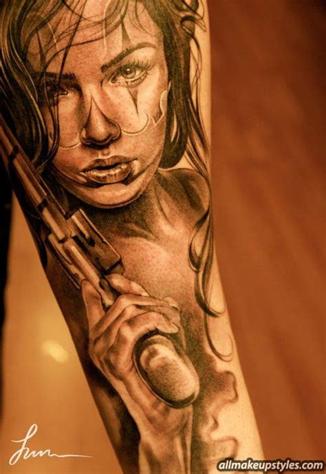 Tattoo Girl With Gun | gun tattoos and designs page 52