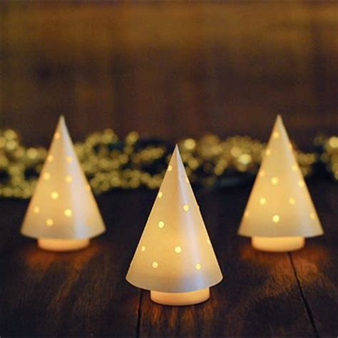 glowing mini christmas trees from paper cone and battery