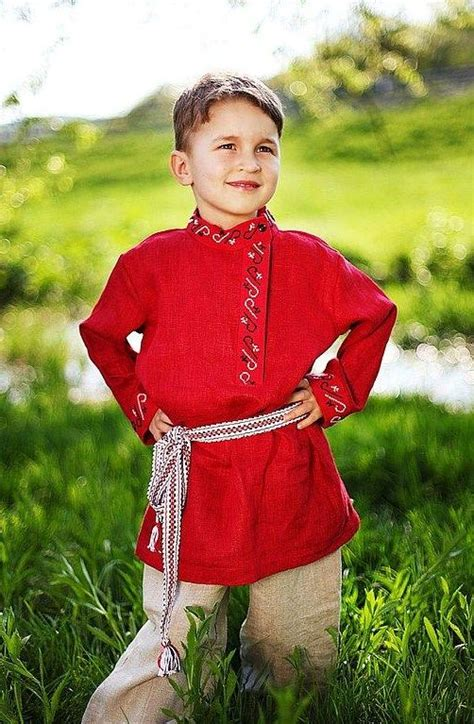 a handsome boy in the russian national shirt
