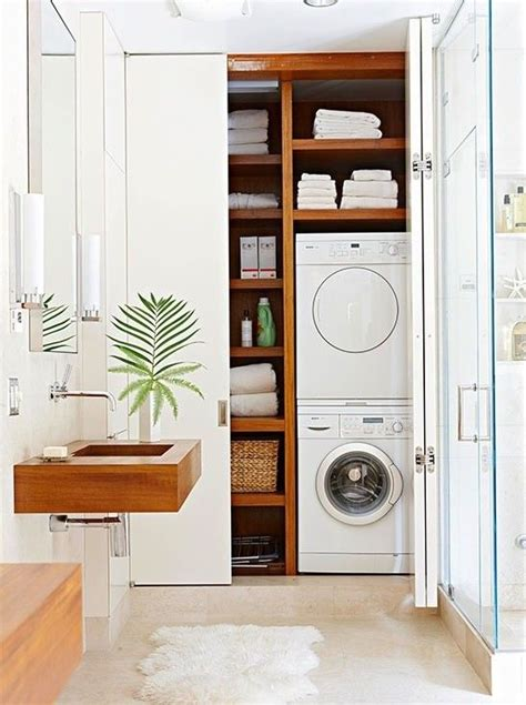small bathroom design with washer and dryer laundry room