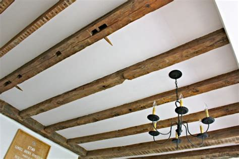 how to install wood beams on a ceiling that s my letter ceiling makeover how to expose wood beams