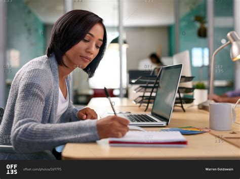 Office Workers by Office Worker Writing Notes At Desk Stock Photo Offset