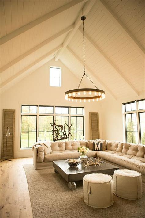 Beige Tufted Slipcovered Sectional With Metal Industrial Cathedral Ceilings In Living Room
