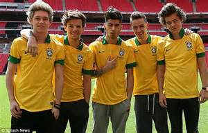Boys for brazil one direction pose in the brazil national team shirts