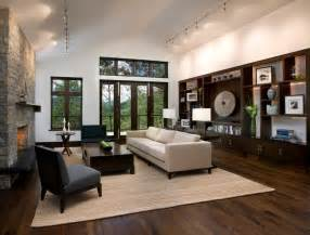 charming Cream And Brown Living Room Ideas #8: Breathtaking-Dark-Hardwood-Floor-with-White-Sectional-Sofa-and-Black-Chair-for-Living-Room-Furnished-with-Bookshelf-and-Small-Furniture-Shelf-Also-Beautiful-Ceiling-Lighting-Decor.jpg