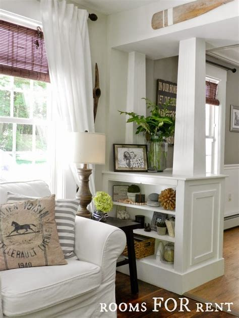 entryway in living room white columns with built in shelves great to divide up a room tear the drywall